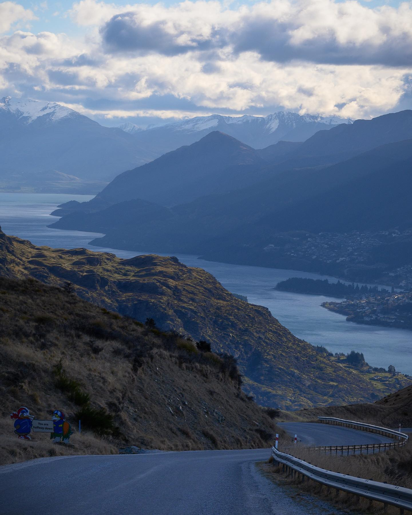 Driving back down from the Remarkables ski resort offers some awesome views over Queenstown (bottom right), Lake Wakatipu, Mount Turnbull (snow top mountain in the background) and the surrounding valley ⛷🌄 . . . . . #queenstown #queenstownlive #lakewakatipu #theremarkablesnz #nzmustdo #purenewzealand #exploremore #ignewzealand #winter #nzgeophoto #nz #nouvellezelande #nztravel #nzgeo #nikonnz #queenstownnz #southisland #nzlandscapes #discovernz #southernalps #adventure #nzlandscapephotography #nztravelmagazine #nzdailyshot #nzstuff  #theremarkables #nzsouthisland #aotearoa #nouvellezélande